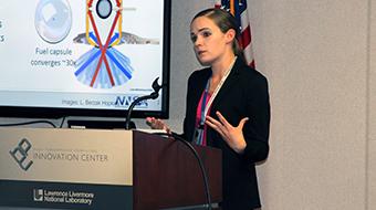 Kelli speaking at a podium at WiDS
