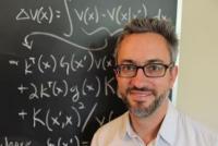 Robert Gramacy in front of a chalkboard