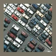 Overhead photo of a parking lot full of cars